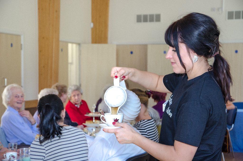 Chichester Co-operative Funeralcare community lunch Olivia Cheesbrough serves tea