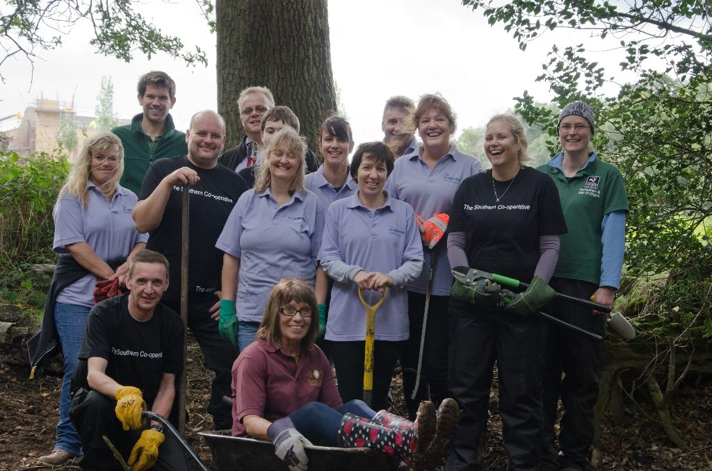 The Southern Co-operative volunteering with HIWWT at Havant Crematorium grounds