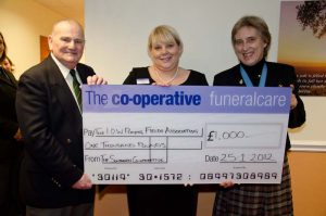 photo of cheque donation to Funeralcare branch Lake