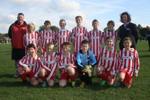 Photo of Camberley Town Under 11 Youth Football team with The Southern Co-operative sponsored kit