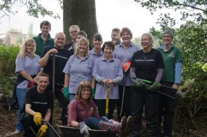 Photo of The Southern Co-operative volunteering with HIWWT at Havant Crematorium grounds