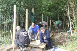 Photo of team volunteering at crematorium natural pond - The Southern Co-operative Funeralcare