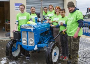 Image of The Southern Co-operative Funeralcare washing tractor for charity