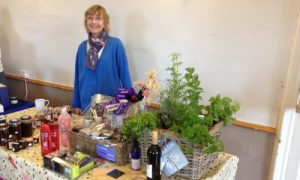 Image of The Southern Co-operative Funeral Co-ordinator with charity raffle entry