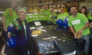 Image of The Southern Co-operative Funeralcare colleagues taking part in charity car wash.