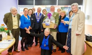 Image of local Samaritan being presented Best Neighbour award by Lord Mayor at The Southern Co-operative Funeralcare in Westbury