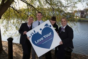 Image of The Southern Co-operative colleagues with Love Your Neighbourhood Logo